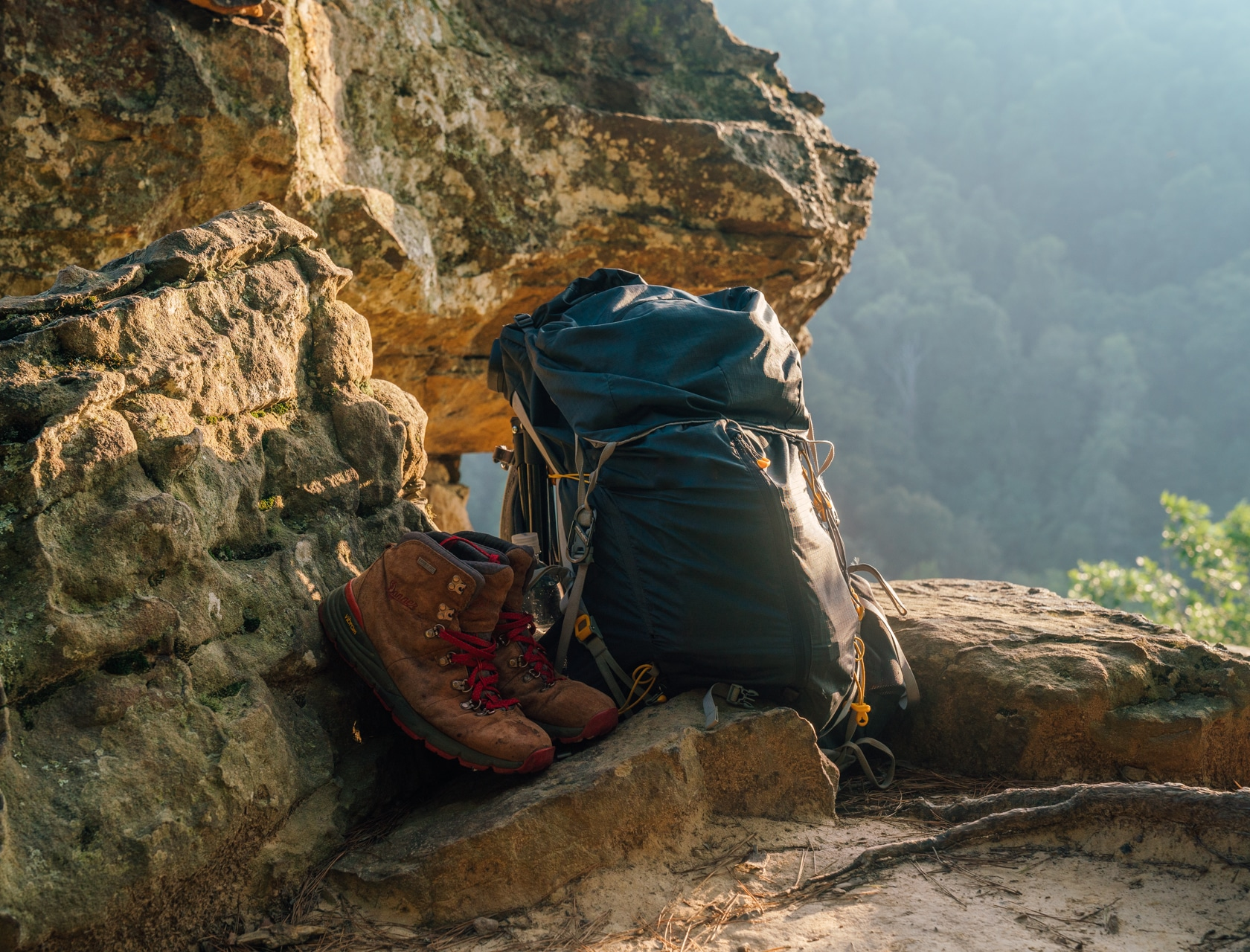 Shoes and backpack on cliffside in upper buffalo wilderness.