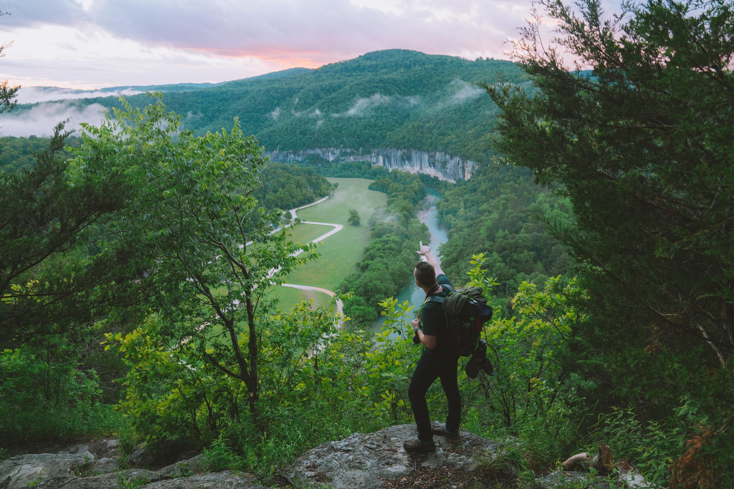 A hiker in Buffalo River Country enjoying the sunset views