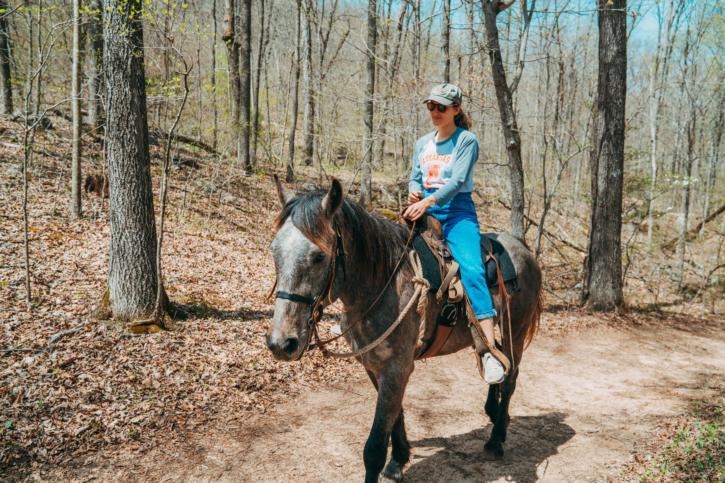 A girl horseback riding in Buffalo River Country