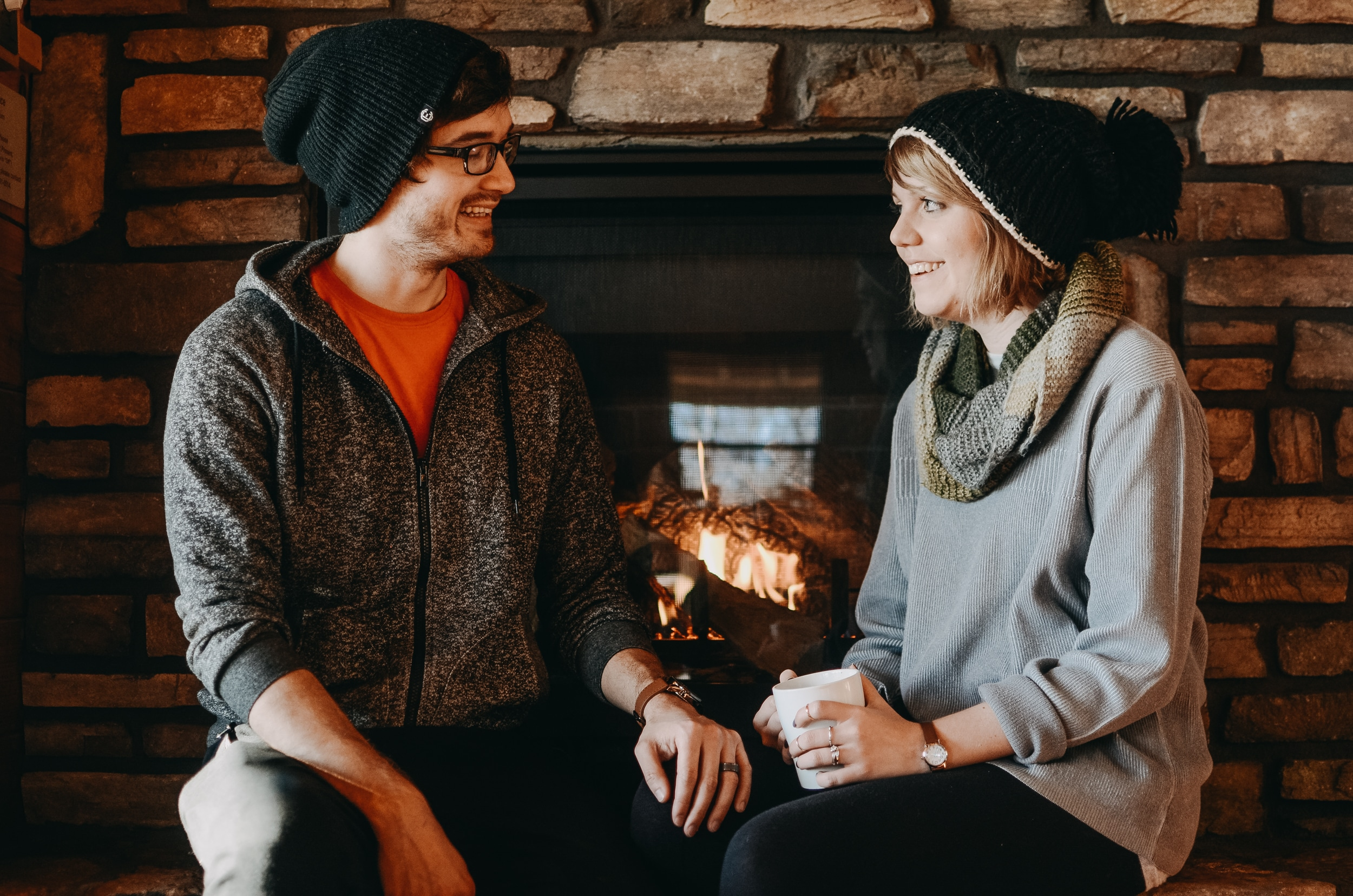 Young couple sitting by the fireplace in a cabin in Buffalo River Valley, Arkansas