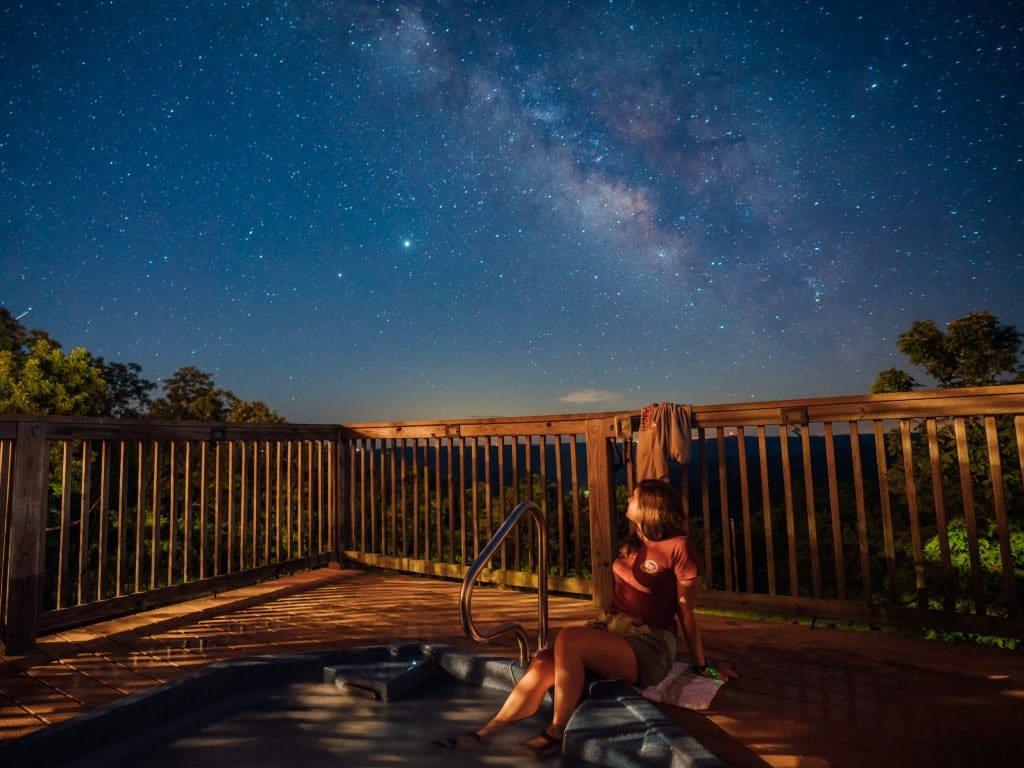 Enjoying a dark sky view from the hot tub at BOC's Riverwind Lodge.
