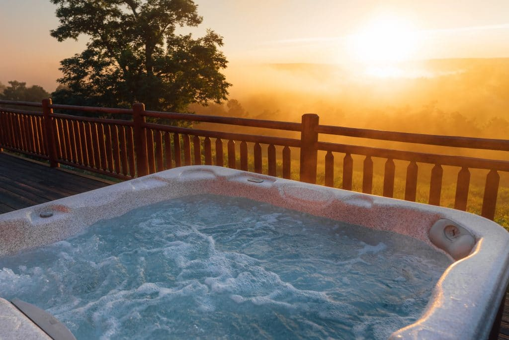 Sunset view from the hot tub of the Mountain Sunset Cabin.